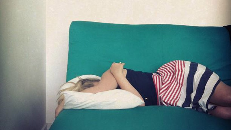 Girl lying on couch