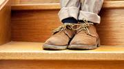 Close up of feet on wooden staircase