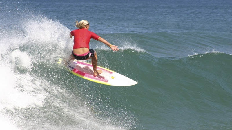 girl surfing big wave